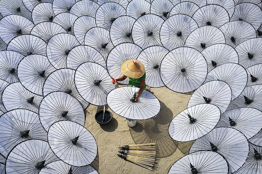 Among the White Umbrellas by Aung ThuYa